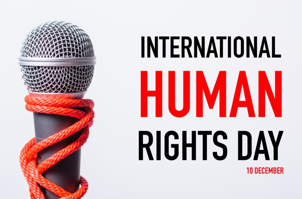 Rope on microphone with INTERNATIONAL HUMAN RIGHTS DAY 10 DECEMBER text